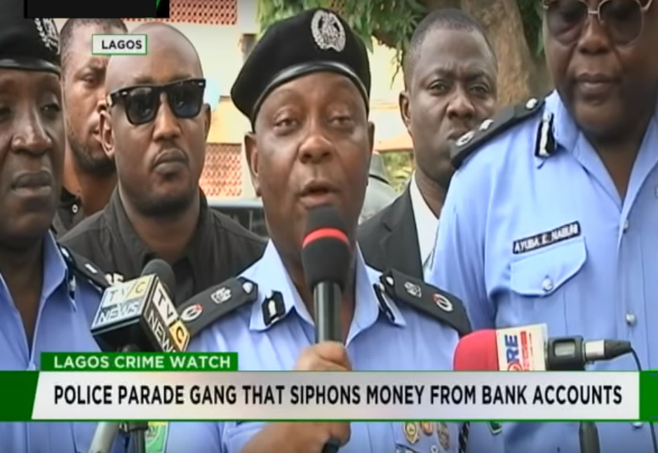 Police are parading gang members for siphoning money from banks through SIM cards